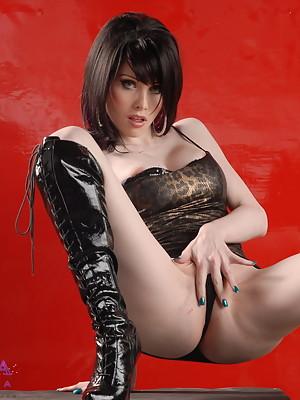 Beautiful Sarina Valentina stripping in pretty boots